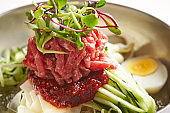 Korean cold noodle with raw beef