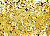 Decorative composition for Birthday, Valentine's Day, Black Friday, Christmas and New Year. Shining golden advertising content of tinsel confetti and ribbons. Flat lay, top view, close up, copy space