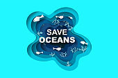 Paper art and cut style concept of World Oceans Day. Celebration dedicated to help protect sea earth and conserve water ecosystem. Blue tone origami craft paper of sea waves. fish and plants under sea