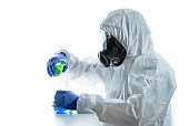 Scientist in personal protective equipment suit or ppe working. Health care, medical and science concept.
