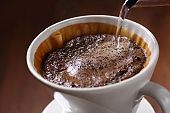 Pour hot water to make drip coffee