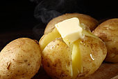 potato with butter on the wooden table