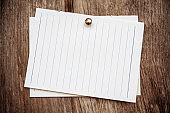 Blank lined paper on wood background textured