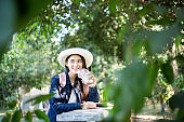 Asian woman portrait drinking coffee at park