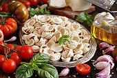Fresh raw  italian pasta orecchiette, vegetables, herbs and olive oil