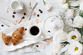 Breakfast tray with coffee cup and croissant