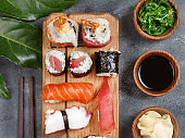 Sushi Set nigiri and sushi rolls on a wooden tray