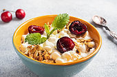 Grain curd muesli with fresh cherries on a plate. Concept healthy Breakfast with cottage cheese and berries.