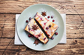 Cheesecake with cranberries and cinnamon. Casserole with cottage cheese on a plate.