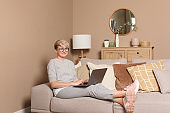 Young happy female freelancer working or learning from home