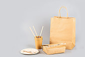 craft paper containers for food on gray background. Food delivery service. Takeaway food during coronavirus covid-19 pandemic isolation, Empty cardboard Paper package. Long web banner with copy space