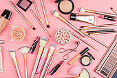 Cosmetic products on pink background. Flat lay, top view