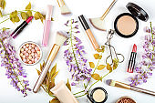 Cosmetic products on white background with copy space. Flat lay, top view