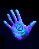 Hand Glowing With Ultra Violet Light Showing Bacteria