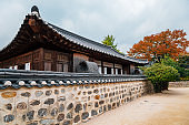 Korean traditional house with autumn maple leaves at Namsangol Hanok Village in Seoul, Korea