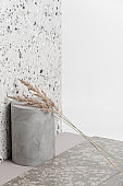 Creative composition of various building decoration materials and dry plants.