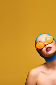 elegant naked girl in scarf and fashionable sunglasses, isolated on yellow