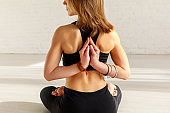 cropped view of woman in reverse prayer pose practicing in yoga studio