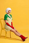 beautiful girl in white wig sitting on chair