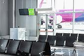 black seats in departure lounge in modern airport