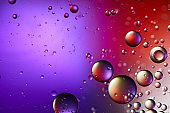 creative purple and red color abstract background from mixed water and oil bubbles