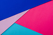 abstract geometric background with pink, blue and violet paper