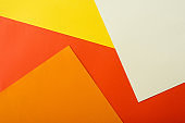 abstract geometric background with white, red, yellow and orange bright paper