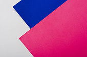 abstract geometric background with white, pink, blue paper