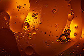 Beautiful abstract background from mixed water and oil in orange