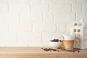 Kitchen background with coffee cup and house decor on wooden shelf