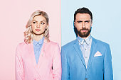 dreamy woman and handsome man on pink and blue background