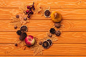 top view of round frame with autumnal decoration on wooden background