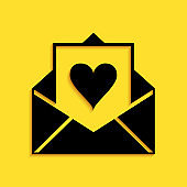 Black Envelope with Valentine heart icon isolated on yellow background. Letter love and romance. Long shadow style. Vector