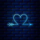 Glowing neon Cupid arrow heart, Valentines Day cards icon isolated on brick wall background. Vector Illustration