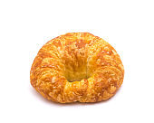 Studio shot one fresh baked French butter croissant isolated on white