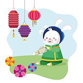 rabbit cartoon in traditional cloth with tea pot cup and lanterns vector design