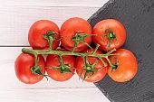 Cherry tomato on white wood