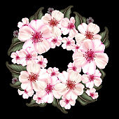 Japanese cherry blossom wreath with pink flowers and green leaves.