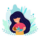 Vector cartoon illustration of Beautiful mother breastfeeds her baby child holding him in hands. Breastfeeding illustration. Mother feeds a baby on leaves background.