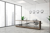 White and brown office corner clocks and reception