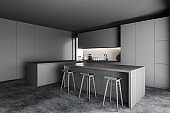 Bar and stools in grey kitchen corner