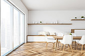 White panoramic dining room interior with cabinet