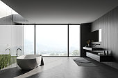 Dark wooden panoramic bathroom with tub and sink