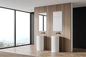 Double sink in panoramic wooden bathroom corner