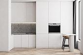 Modern white kitchen interior with bar stools