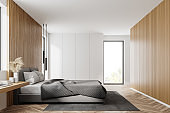 Wooden and white bedroom, side view