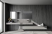 Dark wooden bathroom interior with sinks
