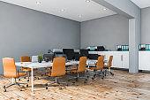 Gray and orange open space office corner