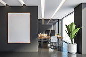Gray office with vertical mock up poster