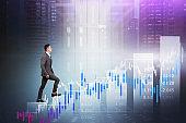 Asian man climbing bar chart in city, data center